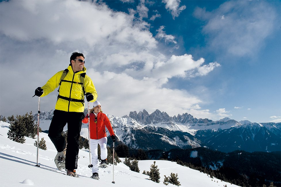 Winter holiday in the Isarco Valley: snowy landascapes in front of a high alpine scenery
