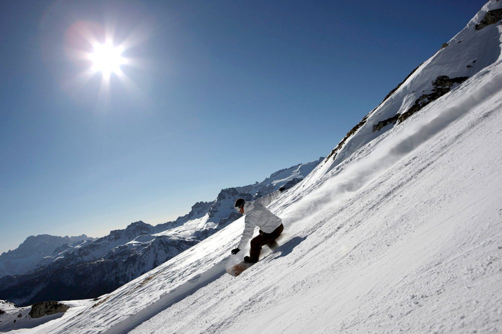 Sunny slopes attract skiers and snowboarders